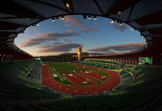 Light from the setting sun reflects off a window on the tower at Hayward Field during the Oregon Twilight meet in May.