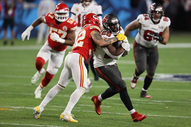 Kansas City Chiefs safety Tyrann Mathieu (32) tackles Tampa Bay during Super Bowl LV on Feb. 7. The Chiefs were last in the NFL in red zone defense and 24th against the run last year.