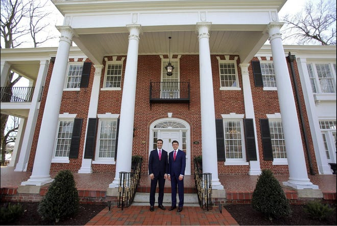 Josh Valentine and Blake Caulder stand in front of the renovated Blanton House in Shelby.