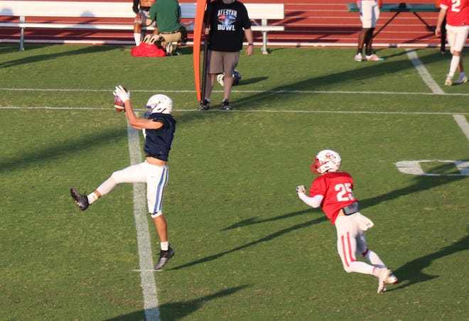 Drae Wood, from Bethel, goes up for a catch Friday night.