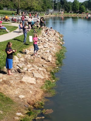 Anglers lined the bank at Windmont Park's lake Saturday for the Kewanee Park District's annual fishing rodeo.