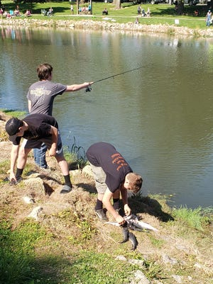 From left, Liam Singleton, Krayten Abernathy and Nathan Schaefer haul in fish at the Kewanee Park District's annual Oldeen Fishing Rodeo at Windmont Park earlier this summer.