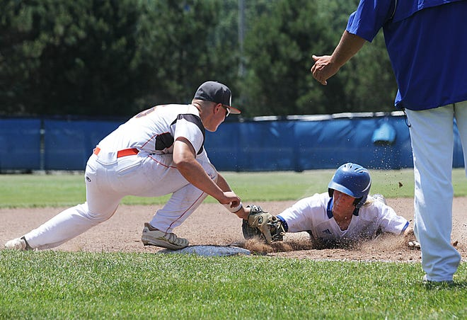 Sturgis third baseman Gibson Cary tags a Harper Creek baserunner out trying to advance on Saturday.