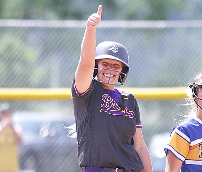 Lynsey Smith of Bronson gives a thumbs-up back to her dugout after hitting an RBI double in the ninth inning against Centreville on Saturday.