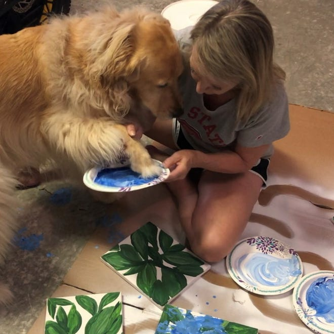 Bleu painting with her mom Ana Brown.