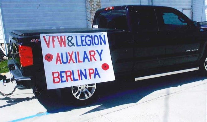 The Berlin Veterans Home 445 Legion and VFW had a float made for them to ride on for the Berlin Memorial Day parade. There were nine who road on the float, and two poppy ladies walking alongside and selling poppies. There was also a poppy dog.