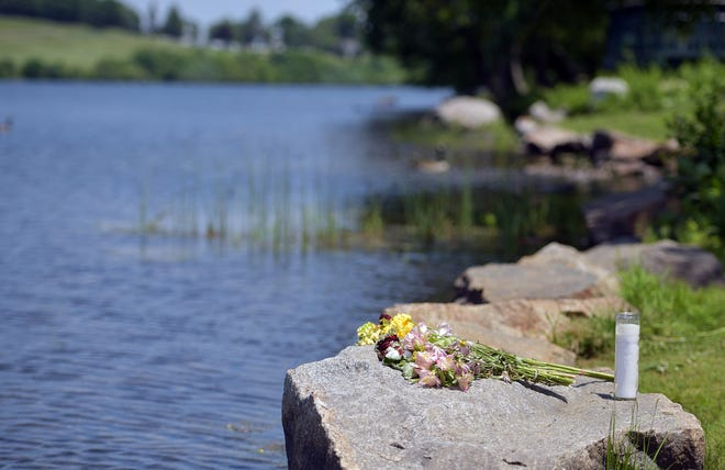 A makeshift memorial at Green Hill Pond in Worcester, where a police officer and teenager recently drowned, and where swimming is not allowed.
