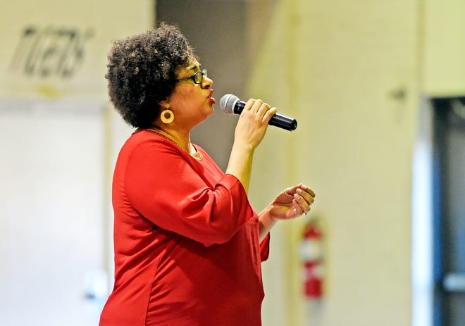 Lorretta Jones, shown singing at a Black History Month program at Gadsden Middle School, will be performing during the local Juneteenth observance June 19.