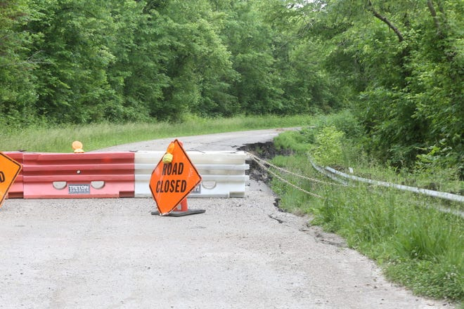 Barriers remain posted on both sides of the road slip on Waterworks Hill Road.