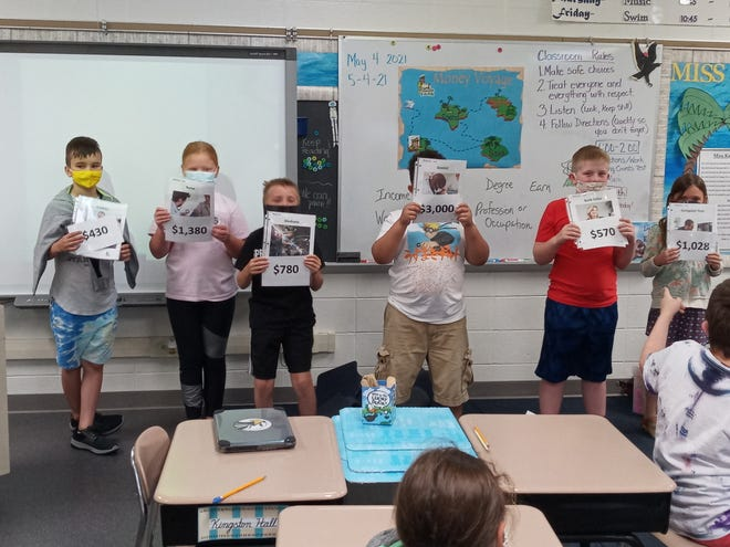 Springs Valley third graders, from left to right, Jacob Richmond, Aliyah Arellano, Michael Carlson, Kingston Hall, Jacob Harris and Capri Purkhiser in Rebecca Elkins' class show their classmates what they learned about different professions during Orange County Purdue Extension's Captain Cash program.