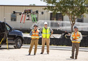 Tyndall Air Force Base officials are using a drone as part of the efforts to create a digital twin of the facility as they continue to build the military base of the future. Brian Leiser, right, controls the drone as Jed Gibson and Chris Scism observe the operation for REY Engineers.