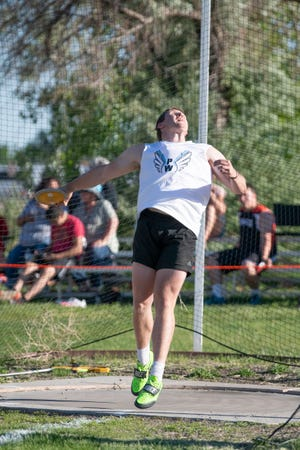 Pueblo West High School's Wyatt Pruce throws a discus during a track meet held at the school on Friday June 4, 2021.