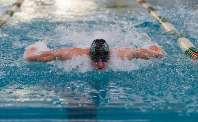 Pueblo County High School's John Plutt competes in the 100m butterfly at the Hornet Invitational in April 2019..