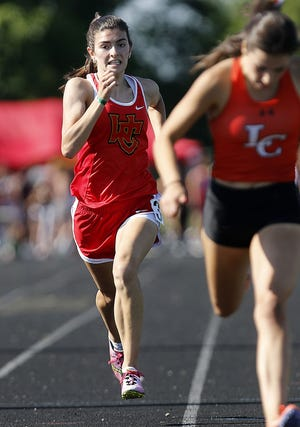 Worthington Christian's Audrey Mousa competes in the 200 meters during the Division III state meet. She reached the awards podium with Grace Hall, Briana Plummer and Maria Klausman on the eighth-place 800 relay.