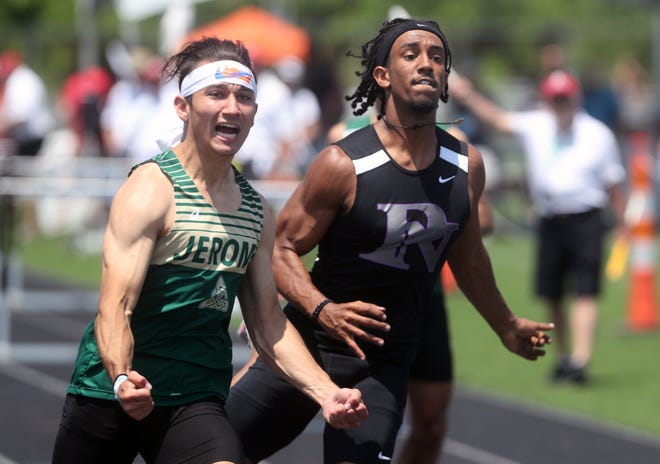 Jerome's Silas Kayuha and Pickerington North's Zemen Siyoum react as they finish first and third, respectively, in the 110-meter hurdles during the Division I state meet June 5 at Hilliard Darby. Kayuha is the program's first state champion.