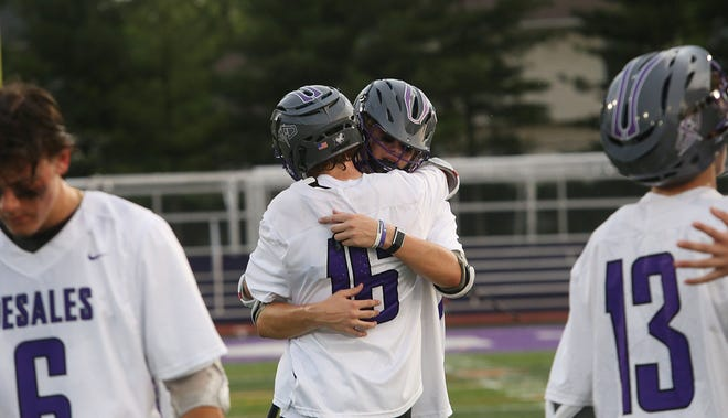 DeSales' David Chintala (16) and Cooper Simpson console each other after a 9-7 loss to Watterson in the Division II, Region 7 final May 27. The Stallions were seeking a third consecutive regional championship.