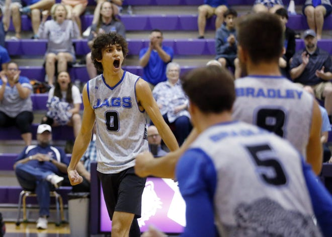 Bradley's Jonah Gilbert (0) celebrates a point with teammates Elijah Solokha (5) and Camden Bartels (8) during a Division I state semifinal against Cincinnati Moeller on June 6 at Pickerington Central. The Jaguars lost 25-17, 23-25, 25-17, 25-20 to finish 19-4.