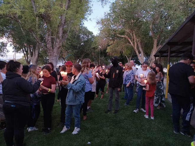 Lucerne Valley residents gather in Pioneer Park on Sunday evening, June 6, 2021, for a candlelight vigil in memory of the young victims of a hit-and-run crash in the community on Saturday.