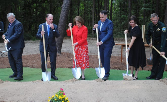 Groundbreaking included (from left) Elder Patrick, Elder Martino, Sister Jennie Martino, President Benjamin Smith, Sister Leah Smith, and Ron Cave, Leon County Sheriff's Department.