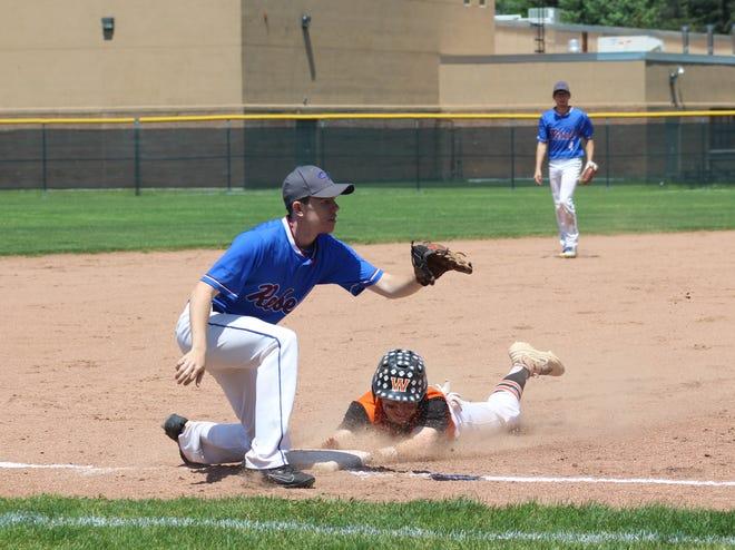 Wellsville senior Alex Ordiway slides into third base for a steal Saturday against visiting Cuba-Rushford.