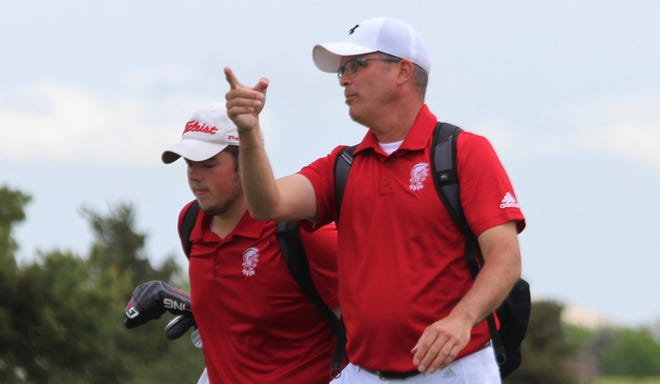 Wellington boys golf head coach James Ginter walking with Brett Wyckoff at the KSHSAA 4A State Golf Tournament in Dodge City