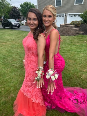 Amanda Pires and Haley McLaughlin, best friends since preschool, pose for a photo on Saugus High School Senior Prom day.