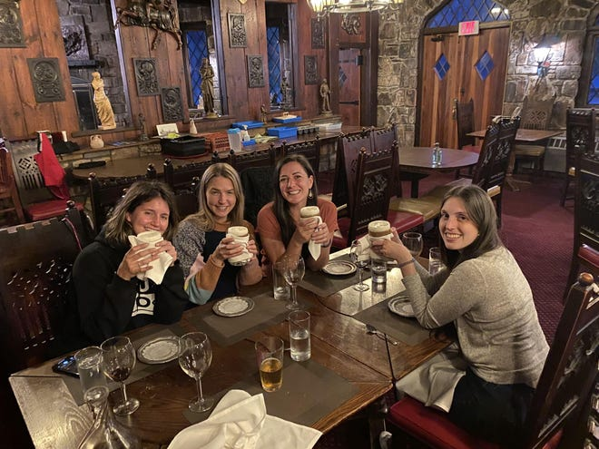 From left, Amanda Setaro, Sarah Connell Sanders, Joy Flanagan, and Molly O'Connor toast to The Castle.