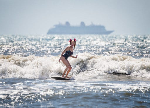 Action from the 20th Waterman's Challenge behind the Cocoa Beach Hilton.