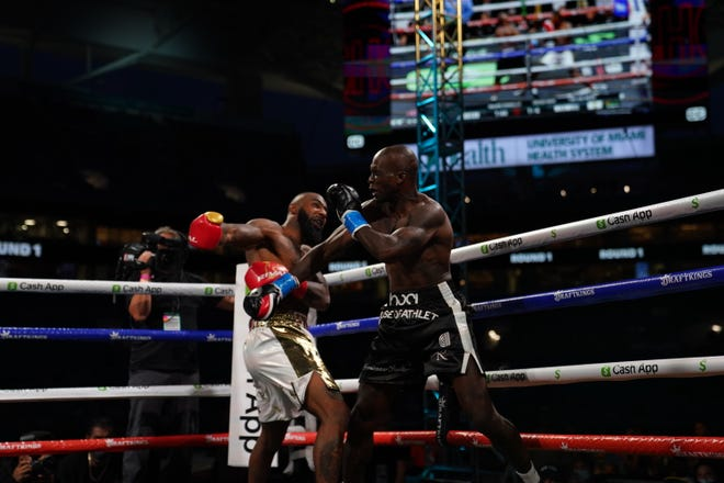Brian Maxwell (White Trunks) fights Chad Johnnson (Black Trunks) during an exhibition boxing match at Hard Rock Stadium in Miami on Sunday night.