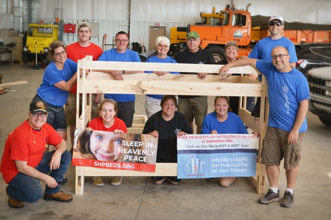 """The new Fond du Lac chapter of the national organization, """"Sleep in Heavenly Peace,"""" recently held its first practice build making bunk beds for local children who are in """"bed poverty."""" The core team is, front row, from left: Kevin Otte, Nora Otte, Tina DeMotts, Theresa Hendrix and Tom Otte, president. Back row, from left: Christine Otte (Co-President), Connor Hendrix and Shawn Coleman, Carol and Dennis Winkel, Karla Breister and Dan Hoffman."""