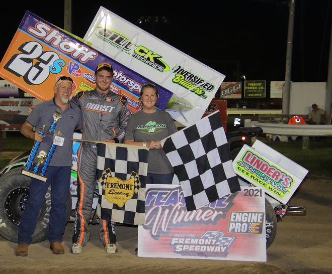 Cole Macedo celebrates in Victory Lane with car owners Ray Brooks and Holy Geary after winning for the second time this season Saturday at Fremont Speedway.