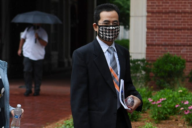 Anming Hu enters the Howard H. Baker, Jr. United States Courthouse in downtown Knoxville, Monday, June 7, 2021. Hu faces charges stemming from the allegation that he hid from UT his dual professorship with a Chinese university.