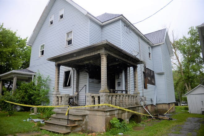 Five people, including two children, were injured in a fire at 115 Arthur Ave. Monday morning.
