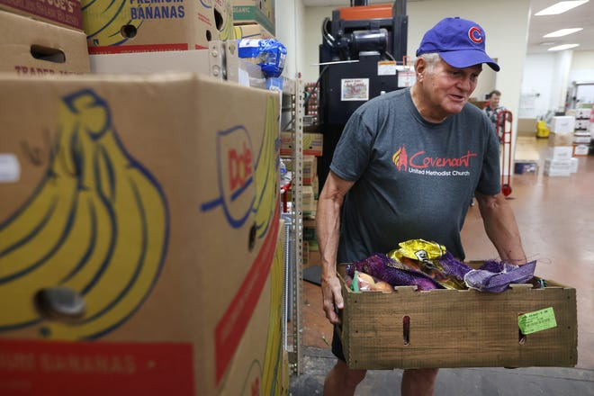 David White, a volunteer with Covenant United Methodist Church, picks of some of the hundreds of pounds of donated food from Trader Joe's in Germantown Monday, June 7, 2021. The donations are eventually distributed to dozens of food pantries across the greater Memphis area.
