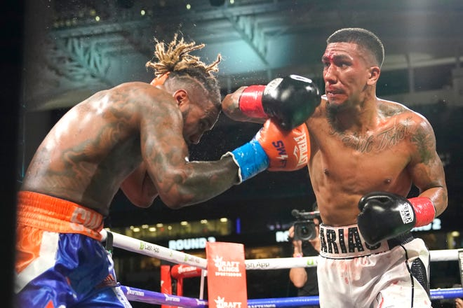 Jarrett Hurd, left, and Luis Arias fight during a middleweight boxing match at Hard Rock Stadium, Sunday, June 6, 2021, in Miami Gardens, Fla.
