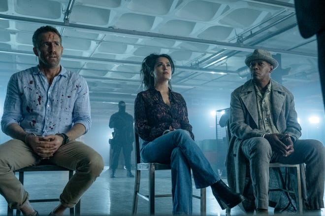 """Ryan Reynolds (from left), Salma Hayek and Samuel L. Jackson are having a bad day (one in a series of them) in """"The Hitman's Wife's Bodyguard."""""""