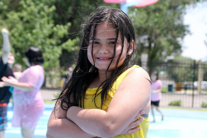 Jayla Alvarez, 10, obeyed the rules and had tons of fun at the Amistad Splash Pad on Saturday.