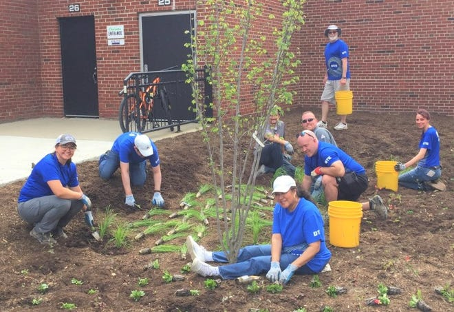 DTE employees spent the morning of June 4 building rain gardens on the property of the Plymouth Arts & Recreation Complex to help prevent flooding of the Rouge River and its tributaries.