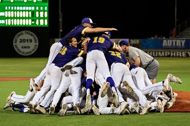LSU Eunice players celebrate after defeating Western Oklahoma State 5-4 to win the NJCAA Division II National Championship on Saturday at David Allen Memorial Ballpark in Enid, Oklahoma.