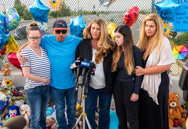 In this Tuesday, May 25, 2021, file photo, family members of 6-year-old Aiden Leos stand at a makeshift memorial on the Walnut Avenue overpass at the 55 Freeway in Orange, Calif., to announce that the reward for information leading to the suspects in the road-rage shooting death of Leos. Family members and friends tearfully remembered Leos, who was shot and killed in the incident on a Southern California freeway, at his memorial service on Saturday, June 5.