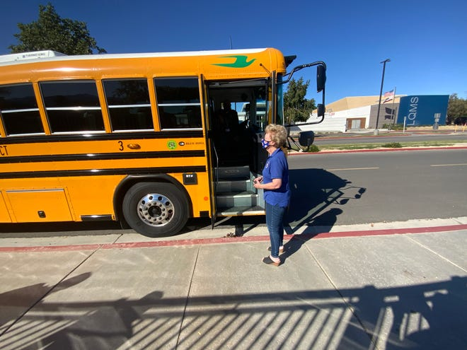 Principal Carol Bishop ready to assist students get on the bus at Harry S. Truman Elementary School