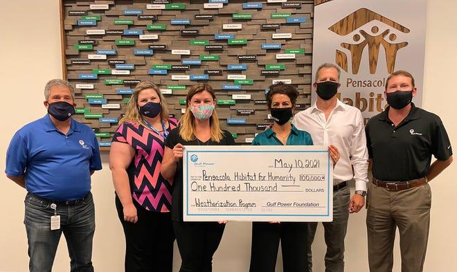 Gulf Power Foundation presents Pensacola Habitat with $100,000 grant.