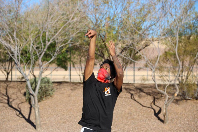 Lareon Ginnis right after shooting the basketball, February 5, 2021, at Basketball court at LIV Ahwatukee apartments, Ahwatukee, Arizona