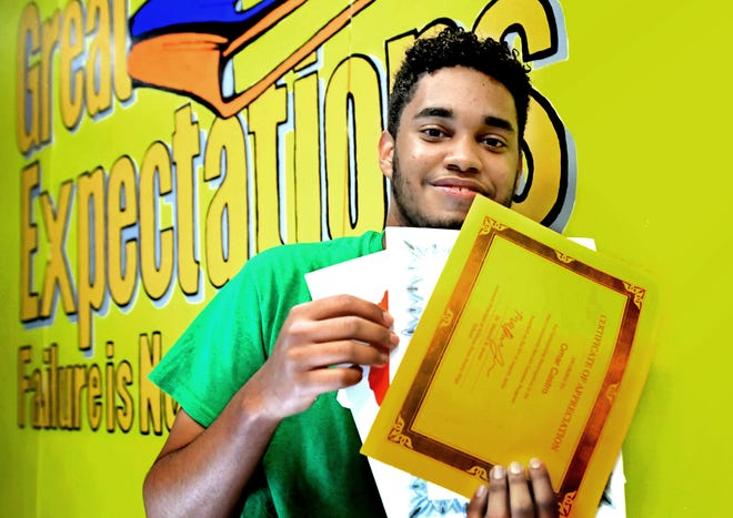 William Penn High School senior Omar Castro holds some of the certificates he's earned during his high school career at the school Monday, June 7, 2021. The immigrant from the Dominican Republic is graduating on Thursday, with a scholarship to York College. Bill Kalina photo