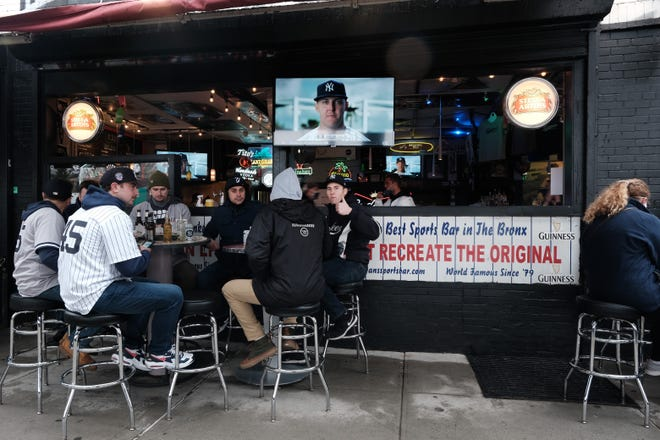 People gather at restaurants and bars outside of Yankee Stadium in the Bronx for the Opening Day of Baseball Season on April 01, 2021, in New York City. (Spencer Platt/Getty Images/TNS)