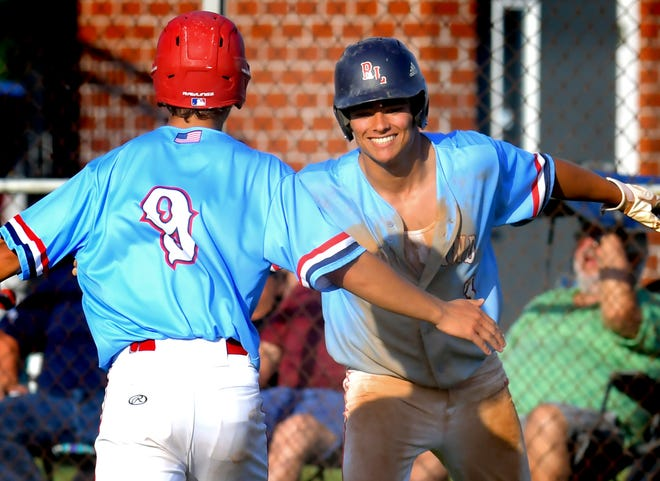 Red Land's Cam Walter and Brady Ebbert celebrate after scoring against Marple Newtown in PIAA Class 5-A first-round baseball action at Red Lion High School Monday, June 7, 2021. Bill Kalina photo