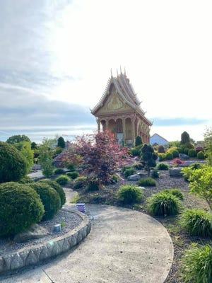 The golden shrine at Wat Pa Lao Buddhadham in Henrietta faces the sunrise.