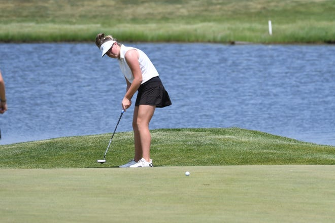 Reese Jansa putts during the first day of the SDHSAA State Girls Golf Tournament at Bakker Crossing Golf Course on Monday. Jansa shot a 5-under (66) to take a 6-stoke lead.