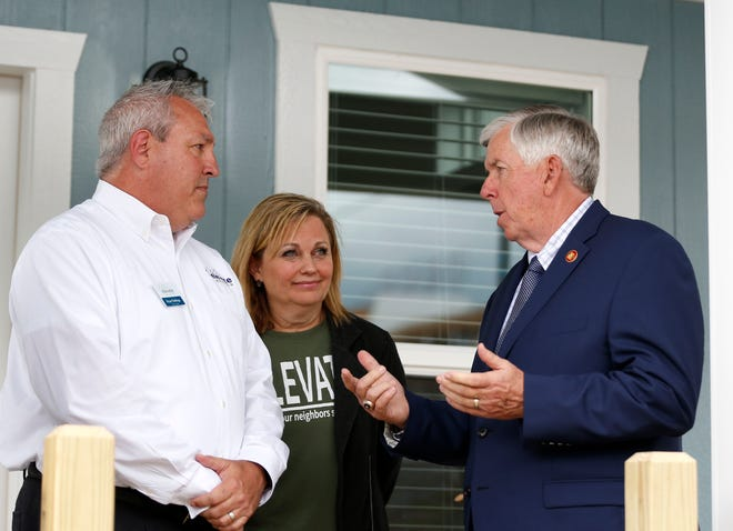 Elevate Branson Founders Bryan and Amy Stallings talk with Missouri Gov. Mike Parson at an example of one of the tiny home that will make up the Elevate Community, a planned tiny home development in Branson designed to help address the lack of affordable housing in the tourist town, on Monday, June 7, 2021.