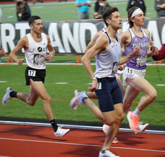 Stan LInton at the starting line in the 10,000 meter race in the Portland Track Festival, an elite track and event, wearing a GWTC singlet.